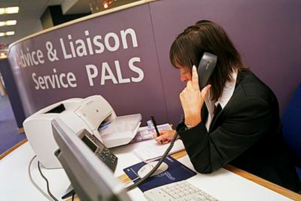 A person taking a phone call for the Patient Advice & Liason Service (PALS)